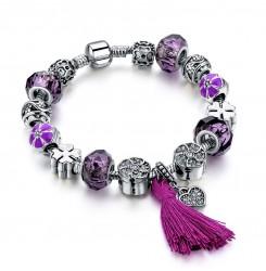 Посребрена дамска гривна с лилави кристални камъни