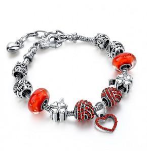 Посребрена дамска гривна с голямо сърце и червени кристали