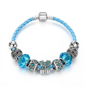 Посребрена дамска гривна със сини кристали и пеперуда