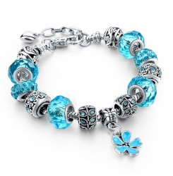 Посребрена дамска гривна със сини кристали и цвете