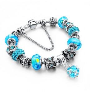 Посребрена дамска гривна със сини кристали
